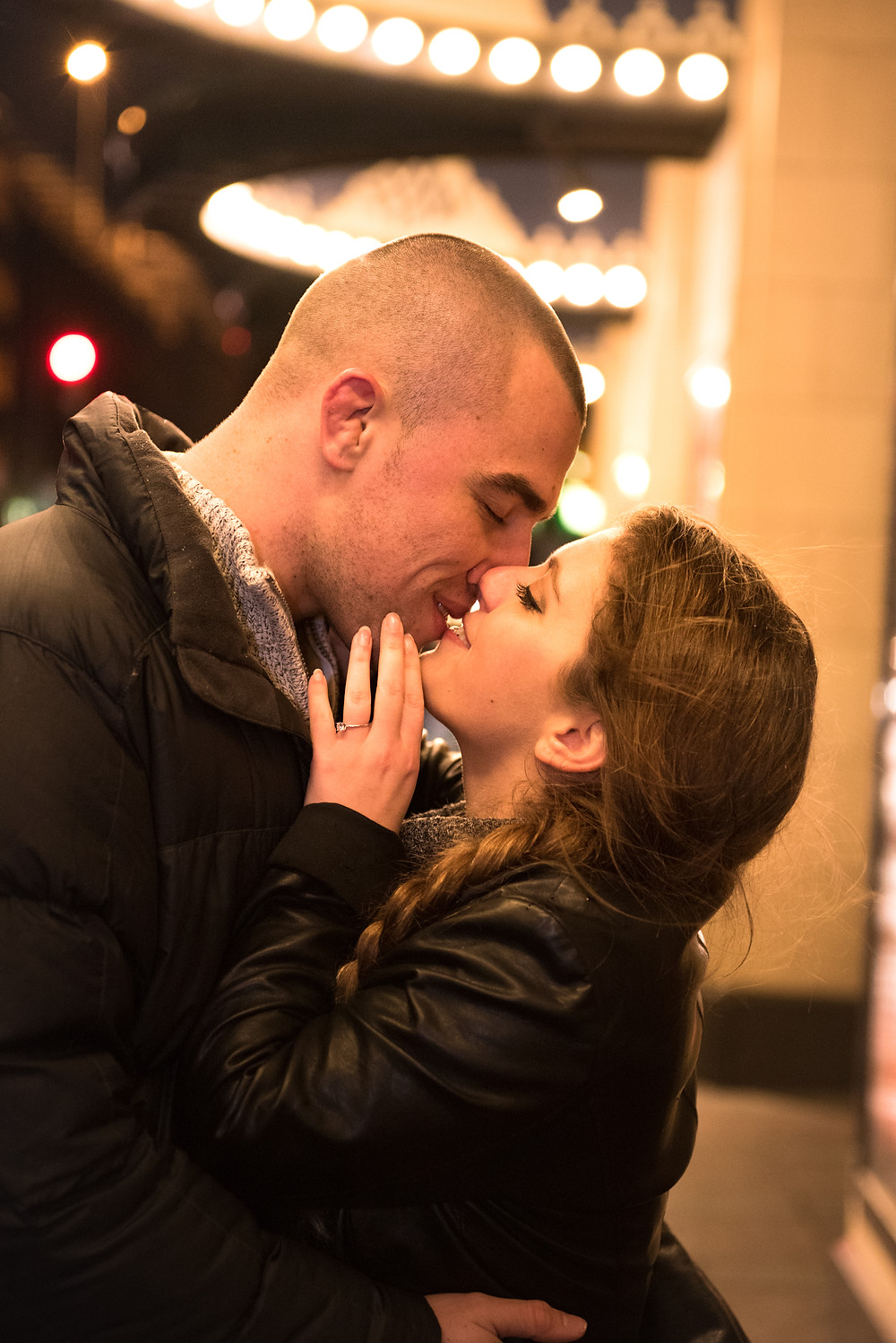 A winter engagement session in Pittsburgh, PA. Couple photographed leaning in for a kiss.