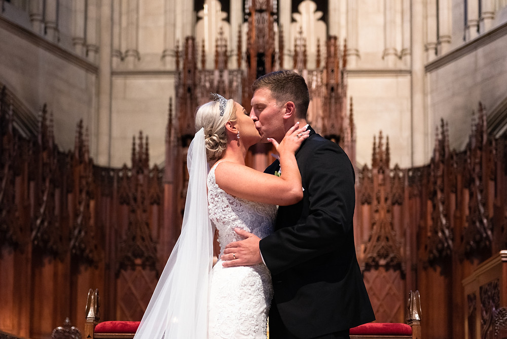 First kiss as husband and wife at Heinz Memorial Chapel in Pittsburgh