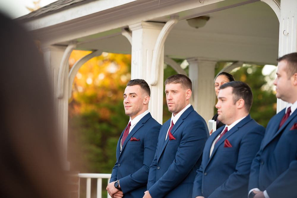 Outdoor fall wedding ceremony; waiting for the bride to walk down the aisle
