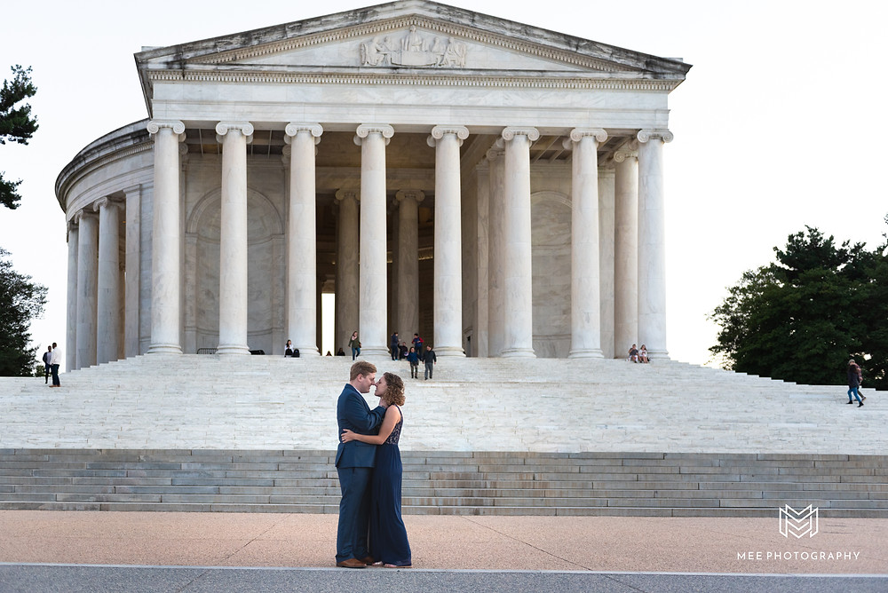 Couple posing for a picture in front of the Thomas Jefferson Memorial