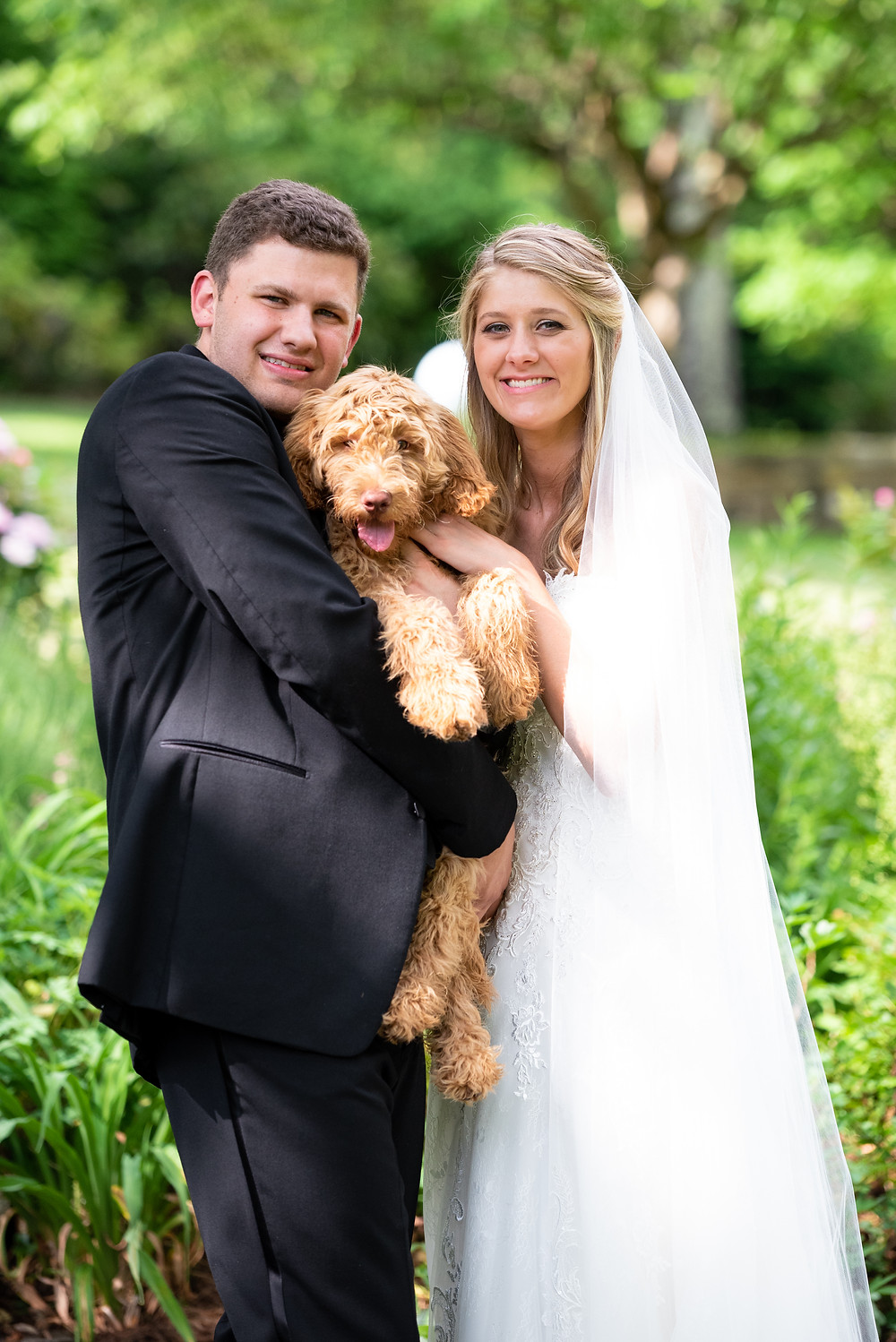Bride and groom photos with their dog