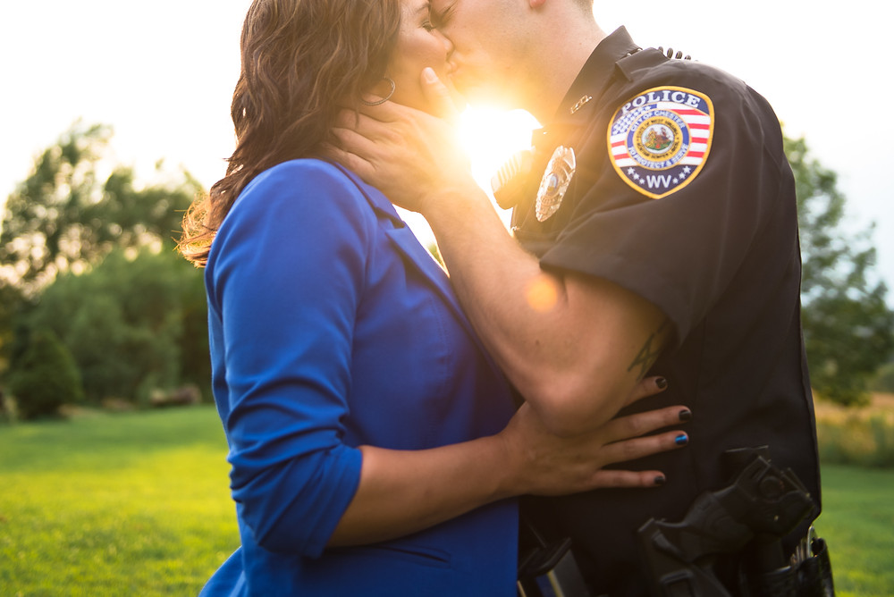 Beautiful sunlight during the couple's police themed engagement shoot near Tomlinson Park in West Virginia.
