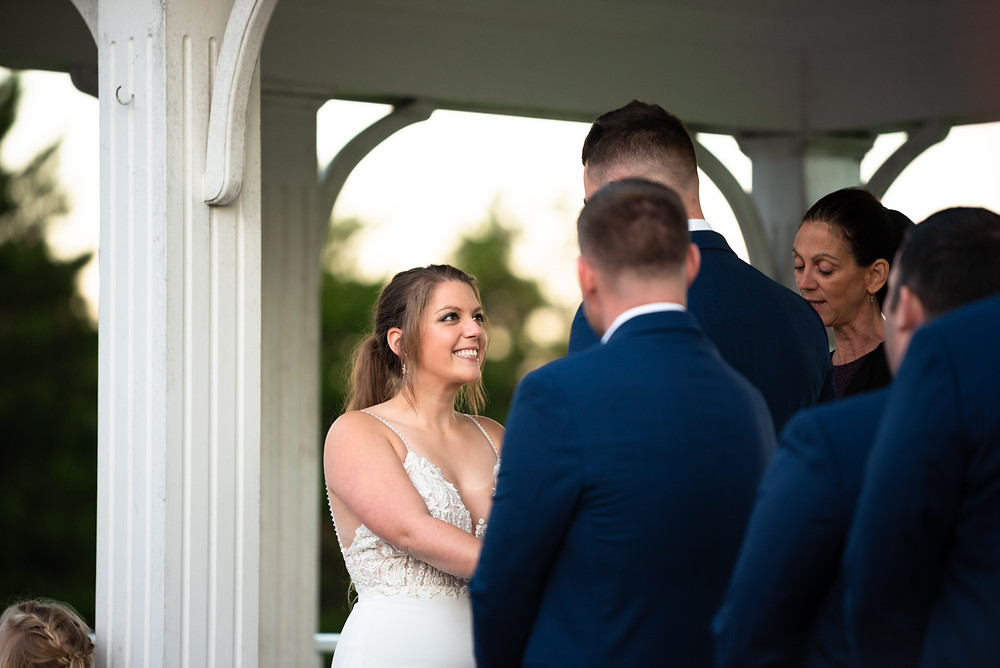 Bride laughing as the groom reads his vows at Morningside Inn