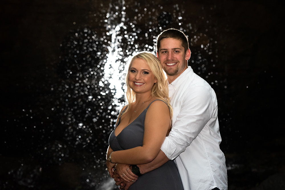 Night engagement photography in front of a waterfall at Raccoon Creek State Park