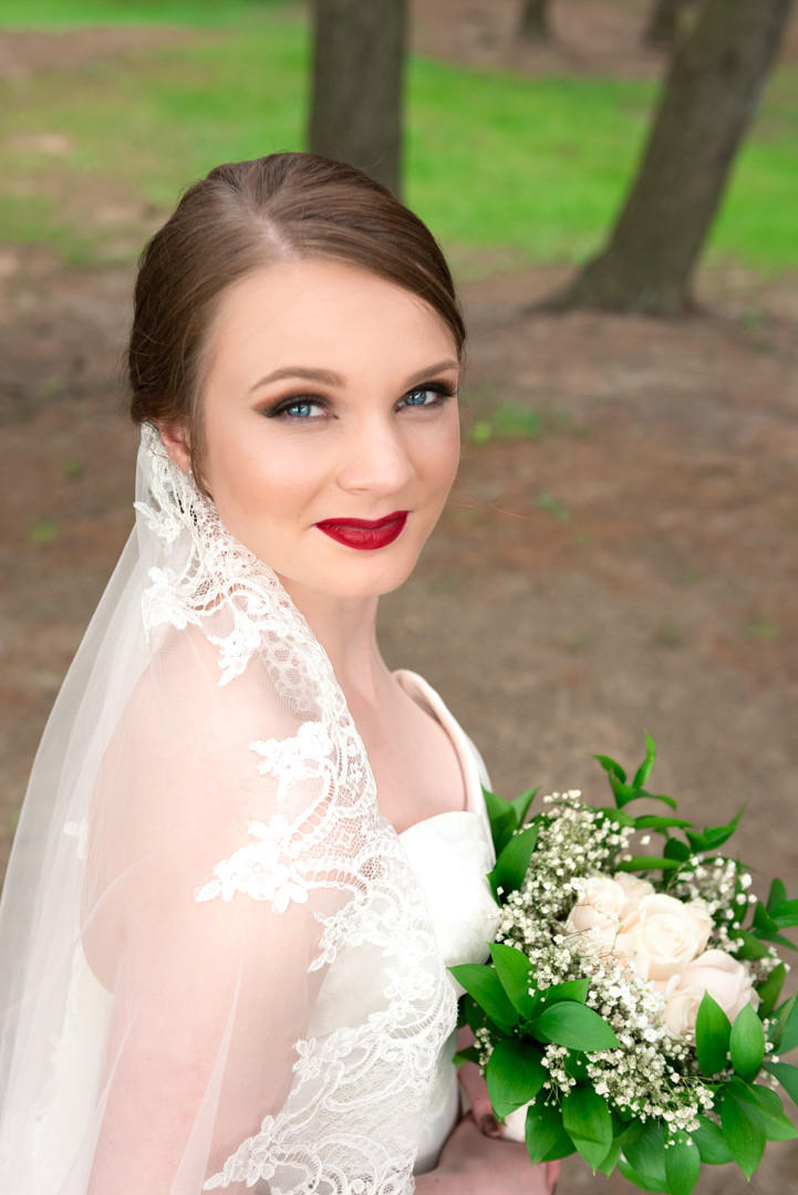 Headshot of a gorgeous bride with red lipstick