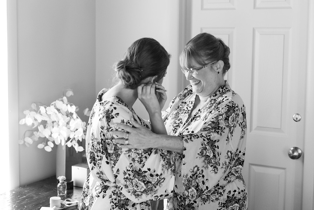 Mother and daughter laughing during the wedding