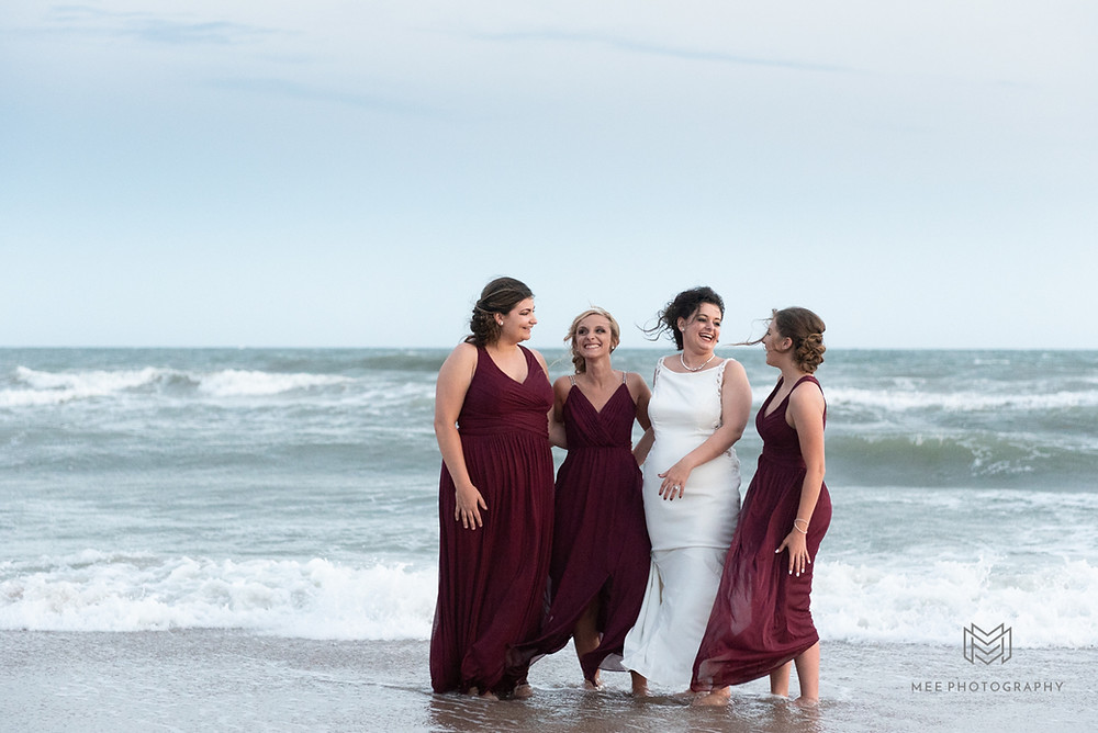 Bridal party portrait in the ocean