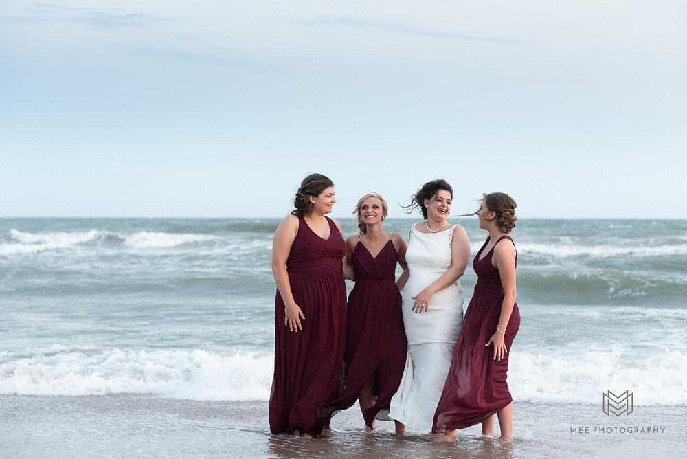 Bridal party portrait in the ocean
