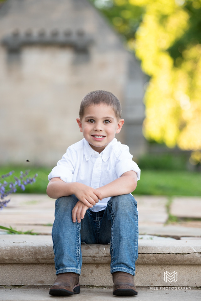 Portrait of a little boy sitting on the stairs at Hartwood Acres Park