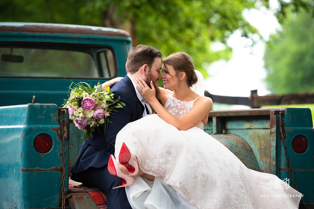 Bride and groom sitting in a vintage Ford truck with bride wearing Louboutins
