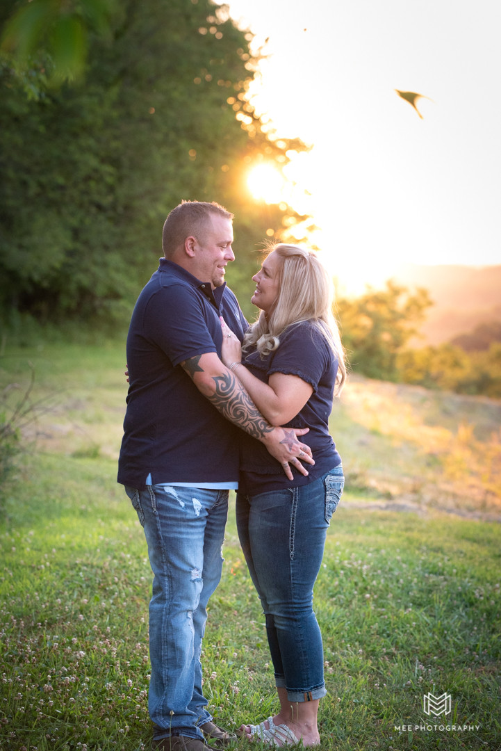 Portrait of parents in jeans posed looking at each other during their family photography shoot