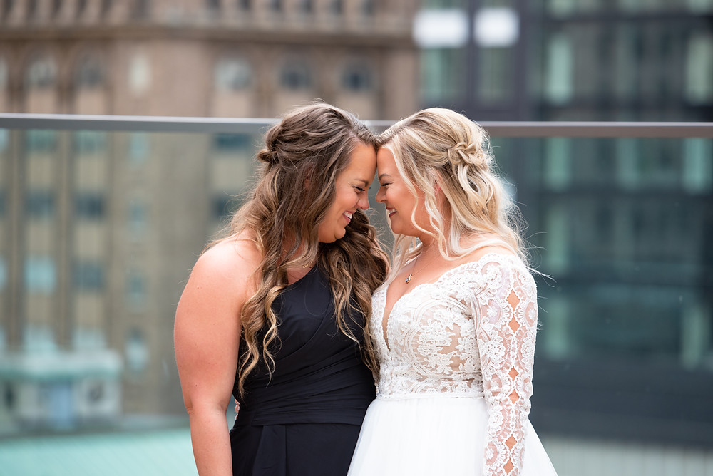Bride laughing with her sister before the wedding