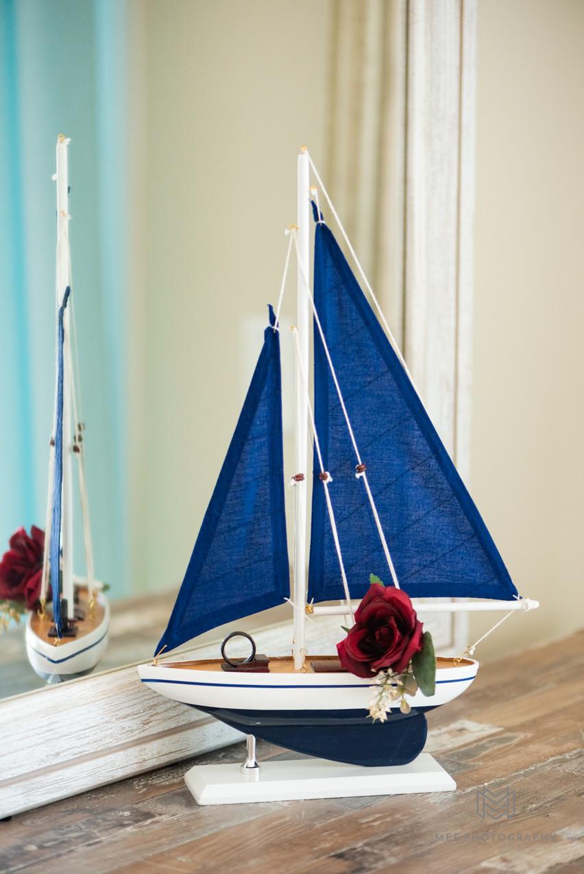 Groom's wedding band sitting on a sailboat