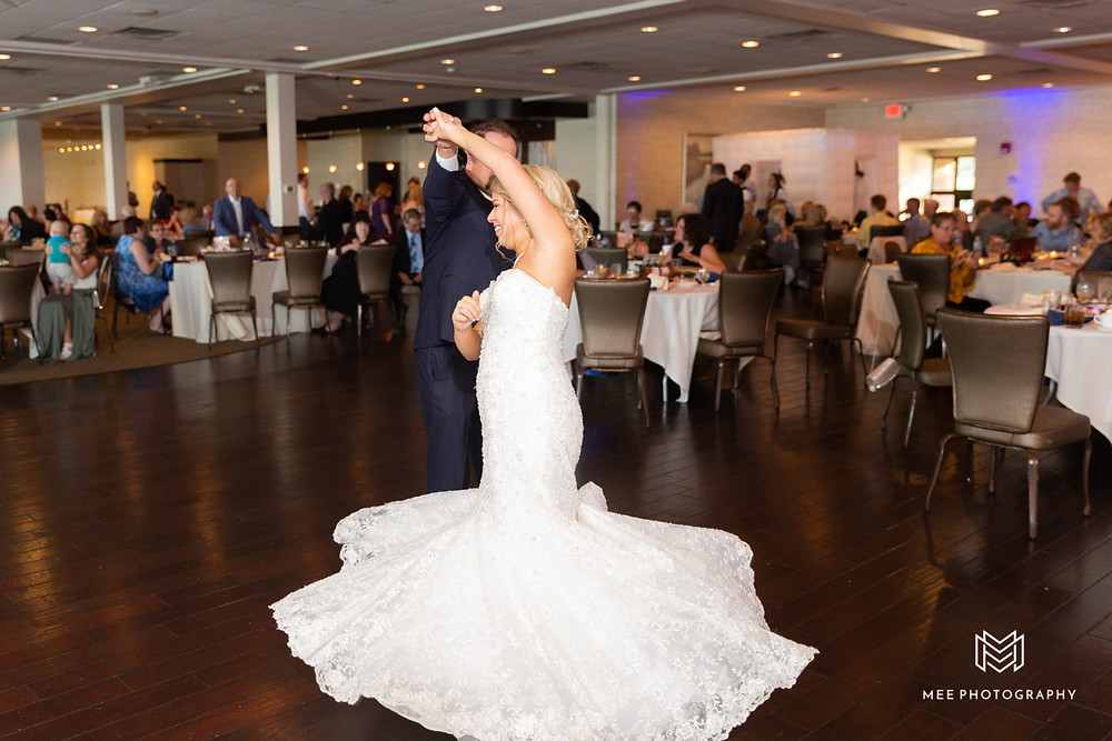 Father daughter dance at wedding reception; dad spinning bride on the dance floor