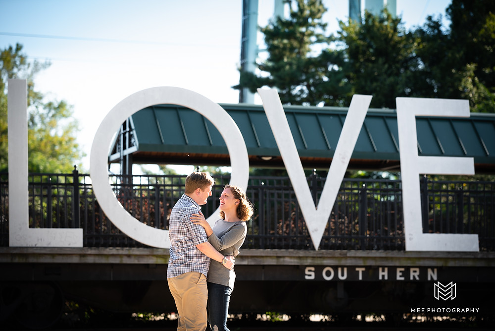 "Manassas, VA engagement photos in front of the ""LOVE"" sign"