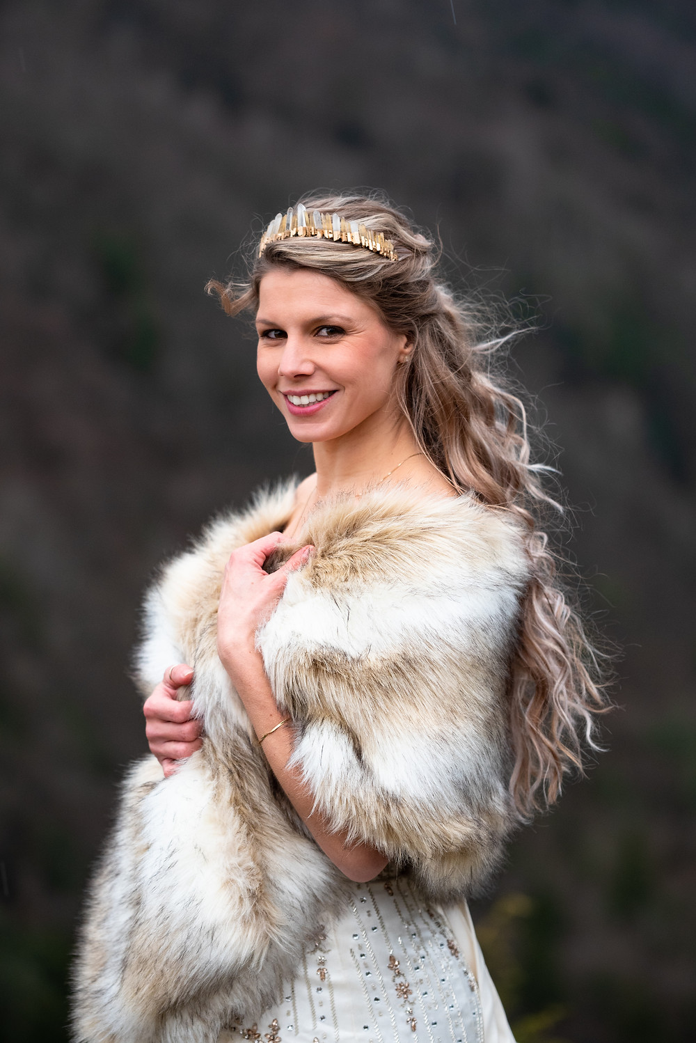 Bridal portrait with crown and fur wrap during this winter wedding in the mountians
