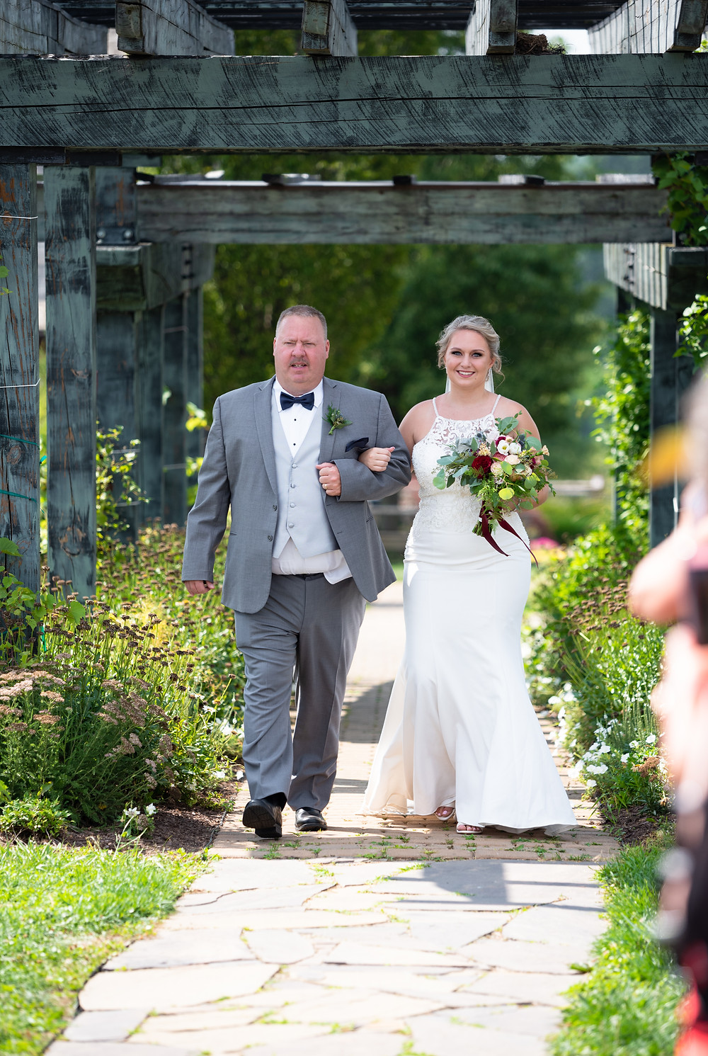 Father of the bride walking her down the aisle at Rich Farms Nursery