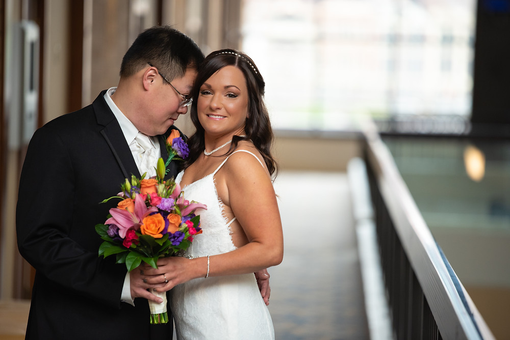 Bride and groom posing at the Sheraton Pittsburgh Hotel