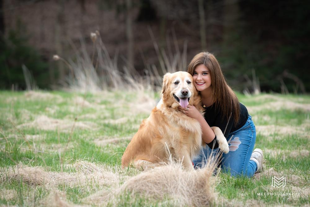 High school senior girl and her golden retriever