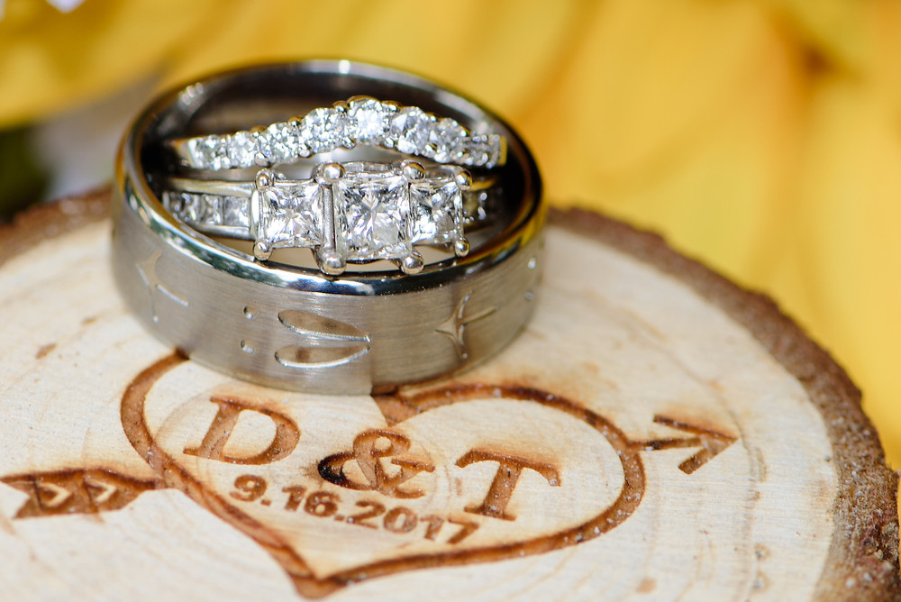 A detail shot of the wedding bands on a ring box with the bride and groom's initials.