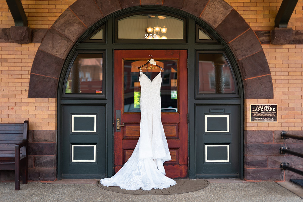 Wedding dress hanging on the door of the Beaver Station