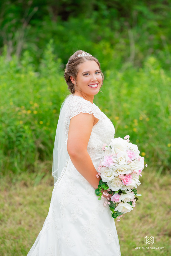 Stunning bridal portrait with bride posed with her back to the camera