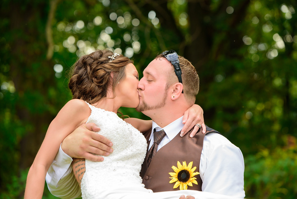 The bride and groom kissing after their wedding in New Cumberland, WV.