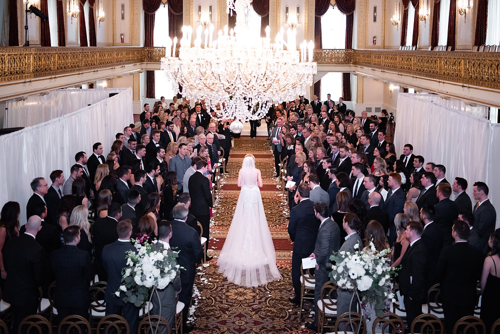 Bride walking down the aisle at the Omni William Penn Hotel in PIttsburgh