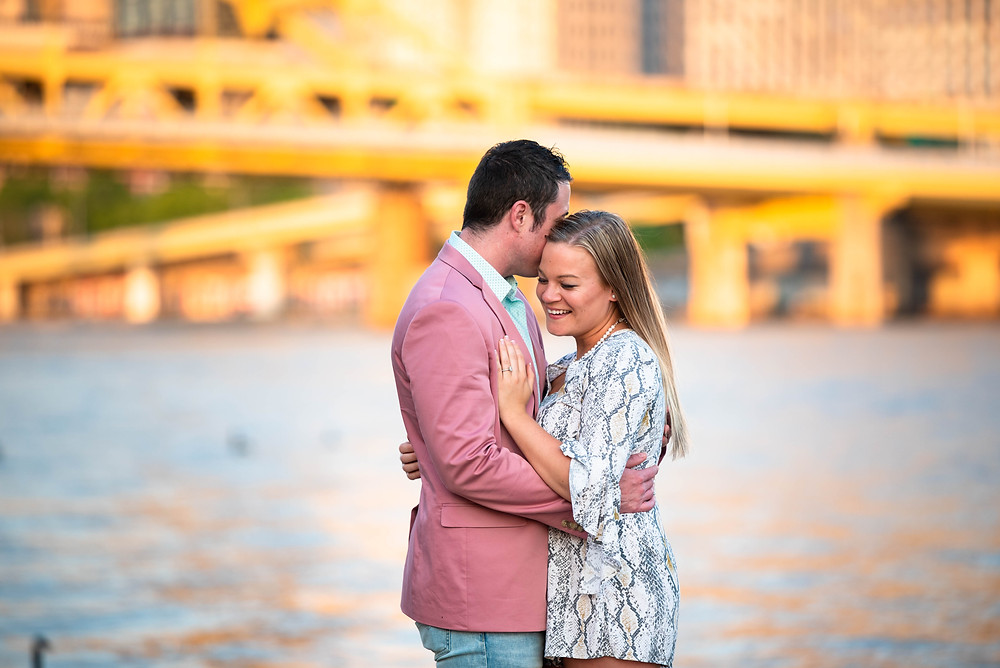 Engagement session with the Clemente bridge in the background