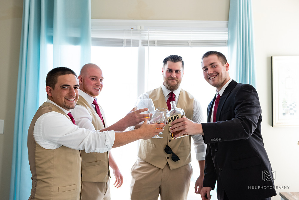 Groomsmen having a drink before the wedding ceremony
