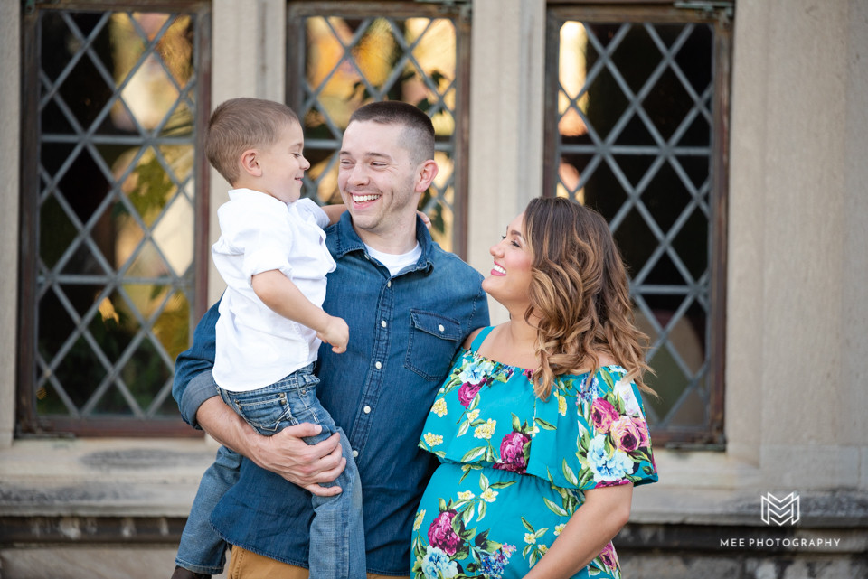 Family laughing during maternity session at Hartwood Acres Park