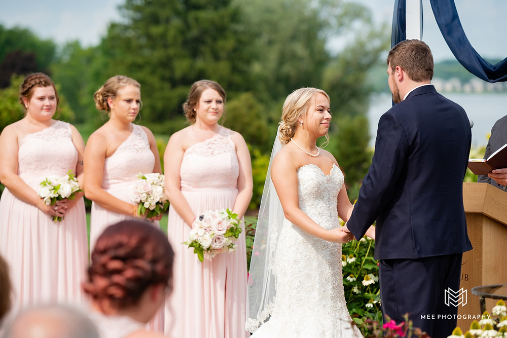 Bridesmaids during wedding ceremony