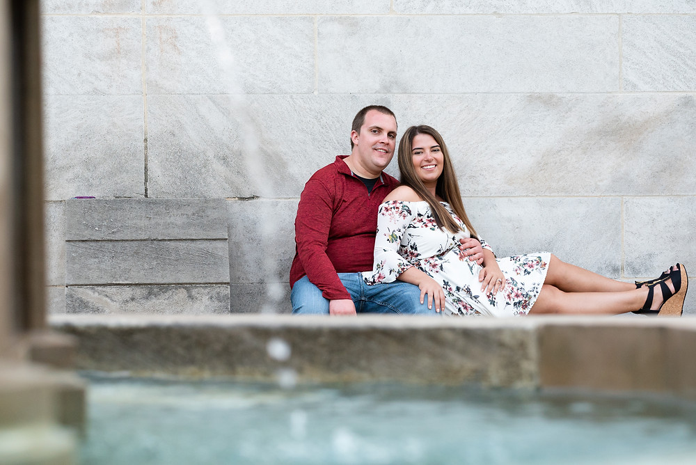Couple sitting by fountain at Mellon Park in Pittsburgh Pennsylvania
