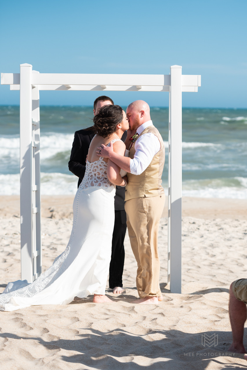 Beach wedding; First kiss as husband and wife