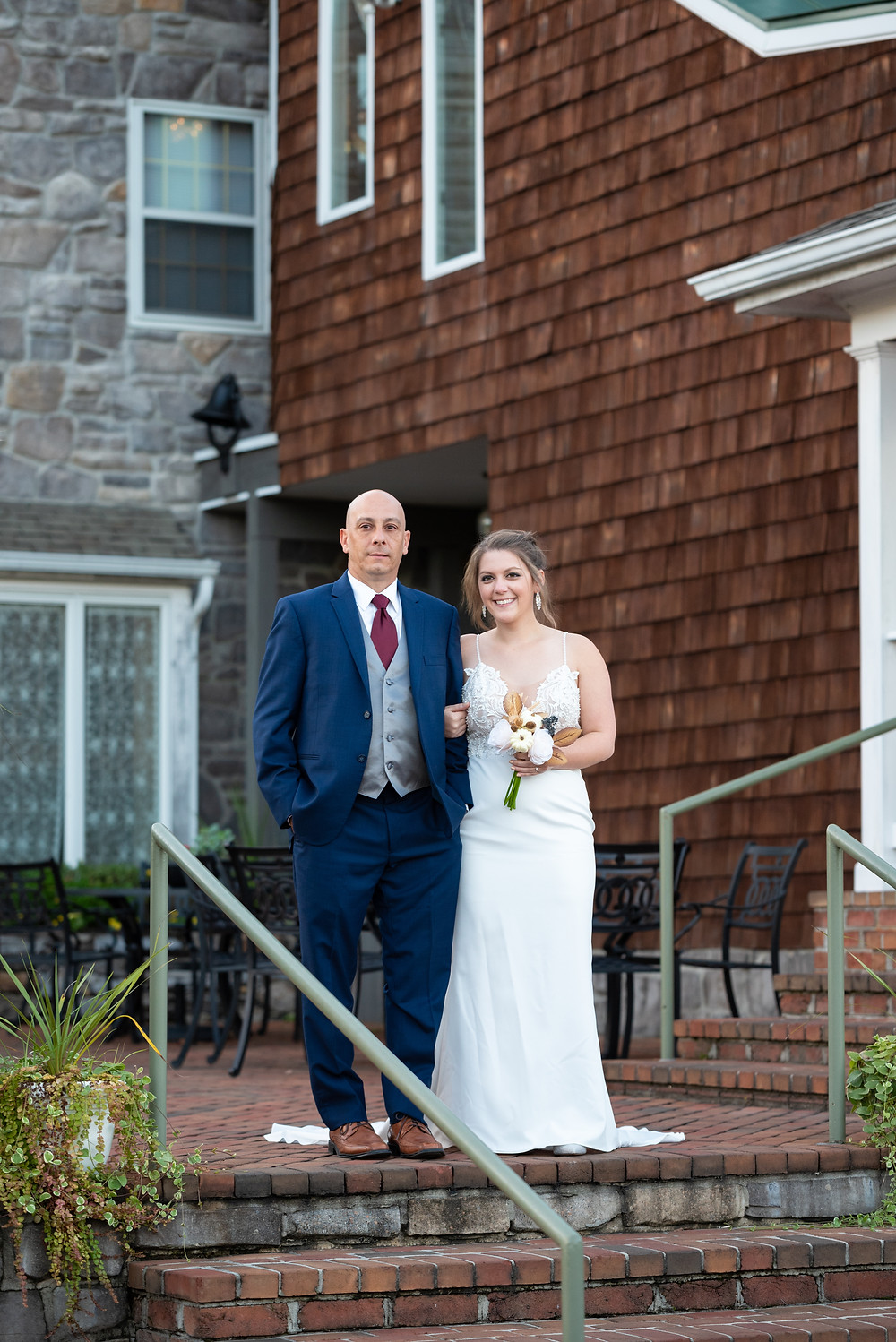 Father walking his daughter down the aisle at Morningside Inn during an outdoor fall ceremony
