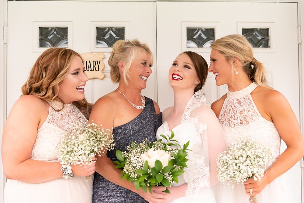 A beautiful mom and her daughters on the wedding day