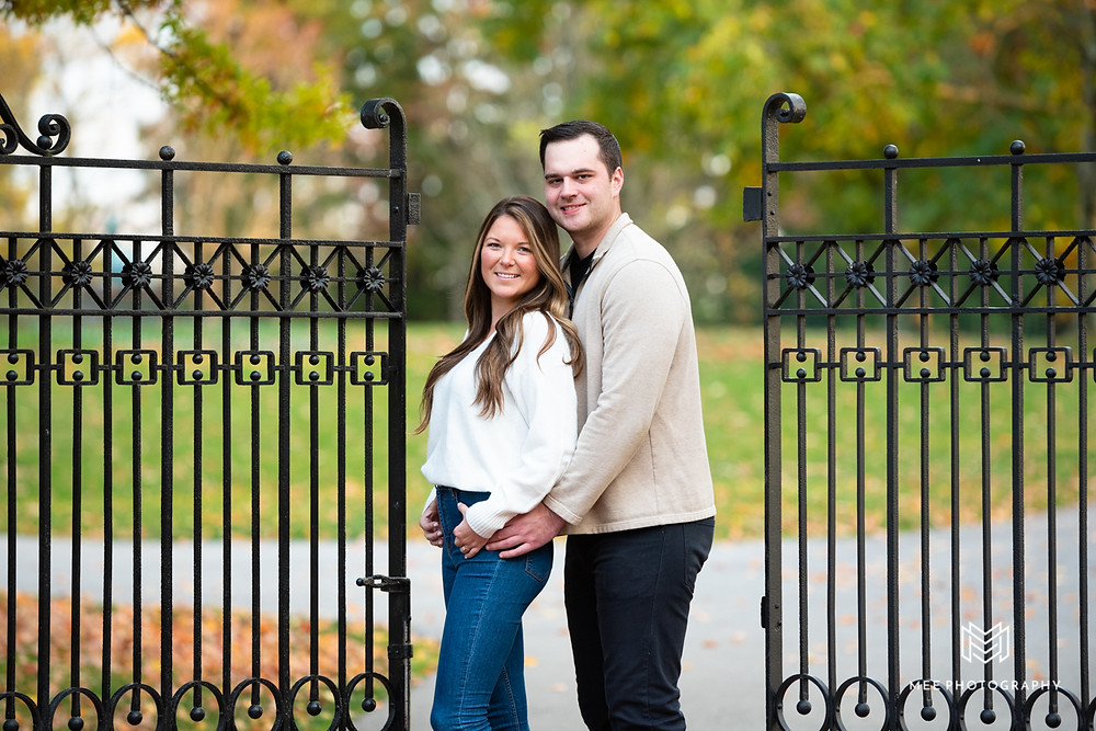 Couple posed in between a wrought iron gate at Oglebay Resort in West Virginia