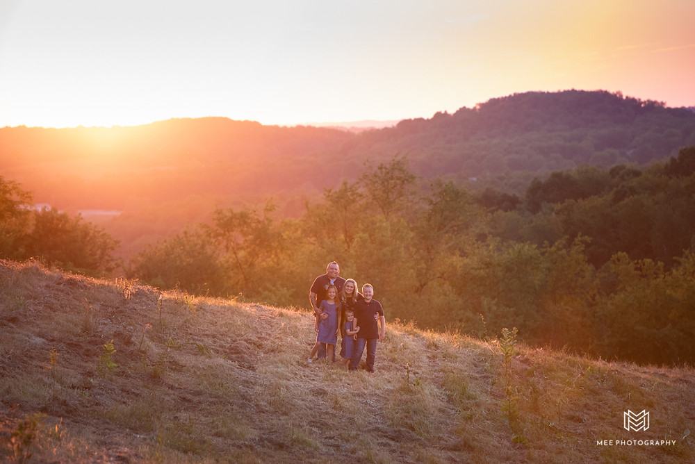 Landscape photograph of a family at sunset with the hills of West VIrginia in the Background