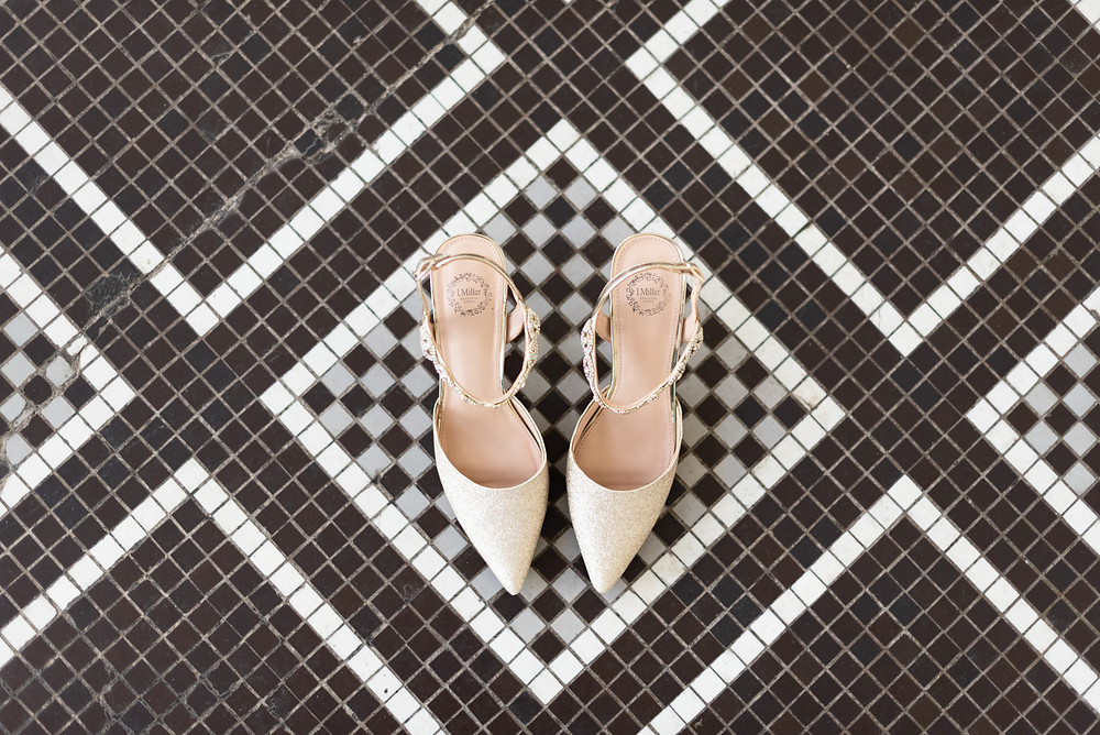 Bride shoes on black and white tile floor at George Washington Hotel