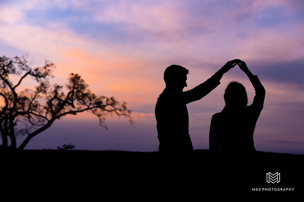 Silhouette of couple dancing at sunset with purple sky in the background in State college, PA