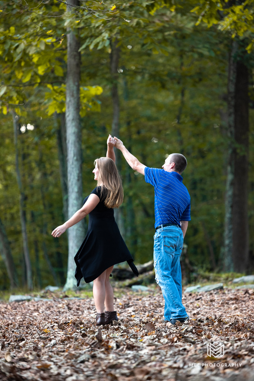 Couple dancing in the woods at Valley Falls State Park in Fairmont, West Virginia