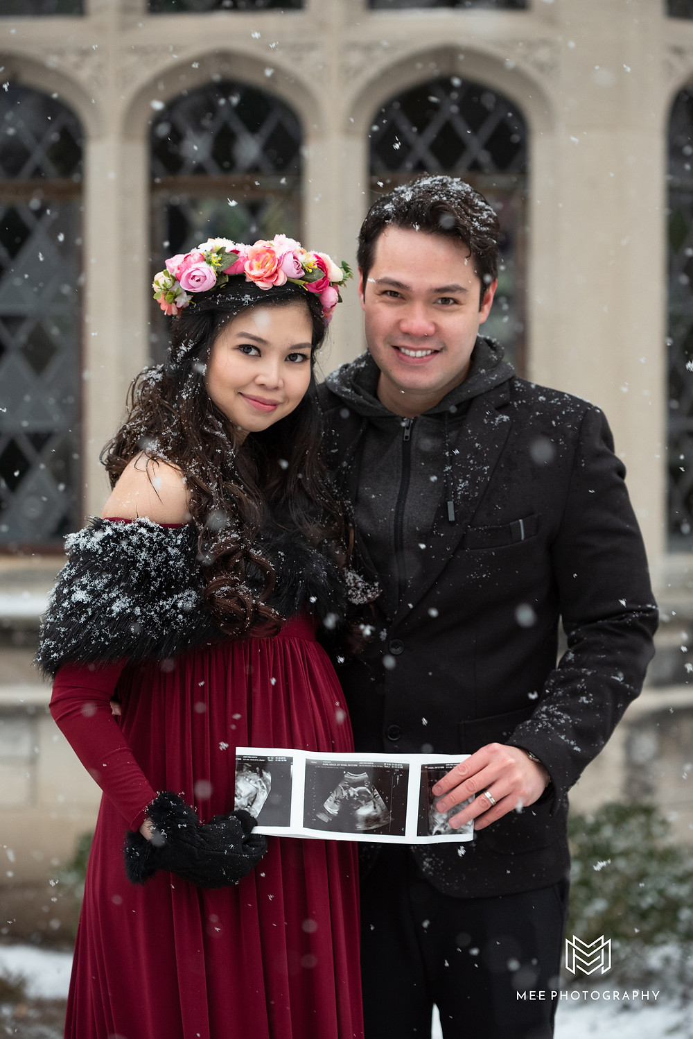 Couple holding ultrasound photos  during their maternity session at Hartwood Acres Park near Pittsburgh