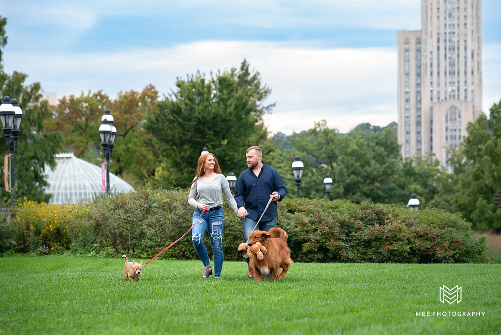 Couple walking their dogs during their engagement session in Pittsburgh