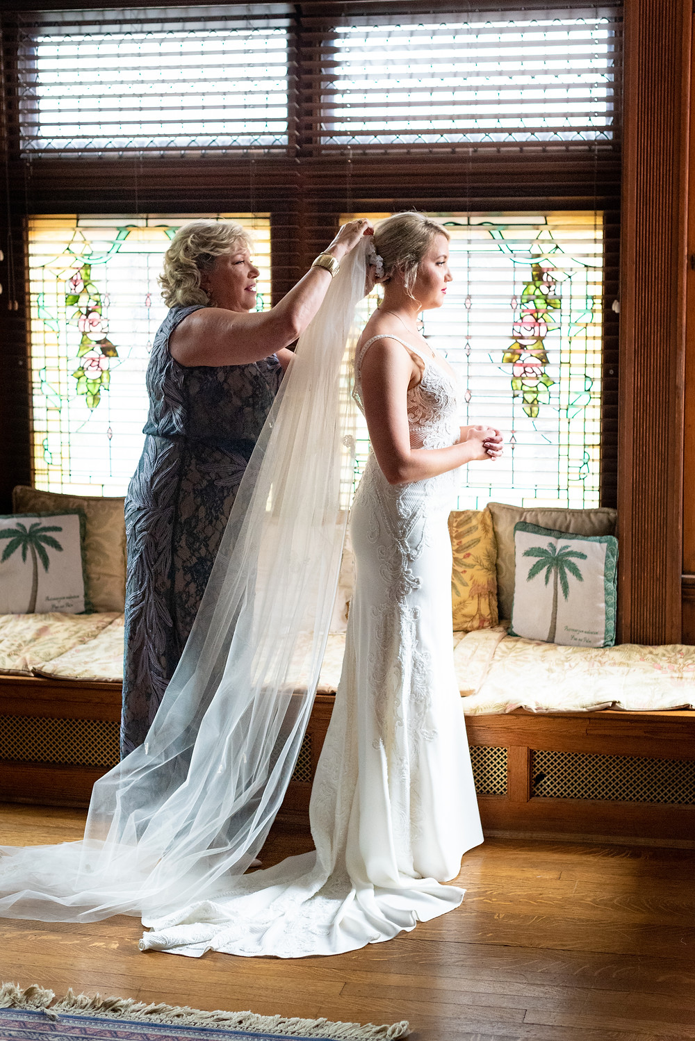 Mother of the bride putting the veil on the bride before the ceremony at The Parador Inn in Pittsburgh