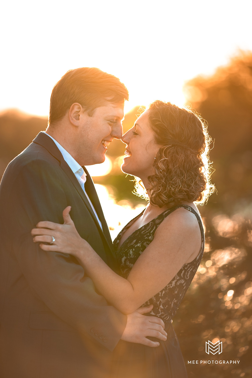 Couple leaning in for a kiss at sunset during their Thomas Jefferson Memorial engagement session
