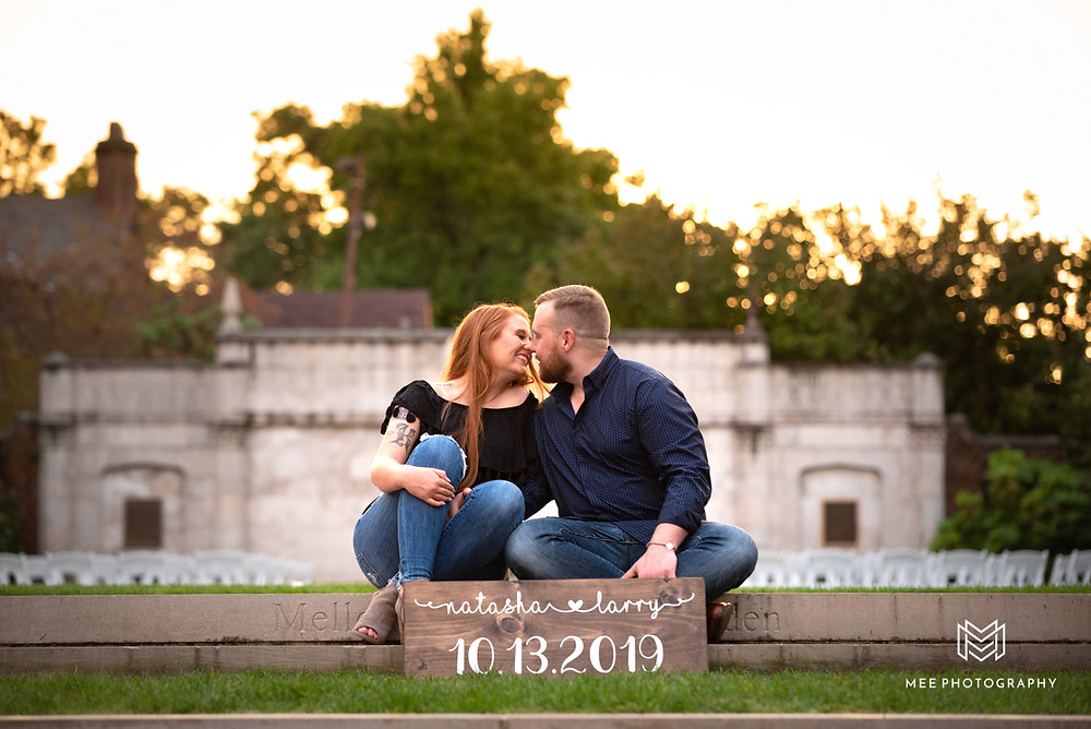 Golden hour portrait with couple sitting on steps during their Mellon Park engagement session