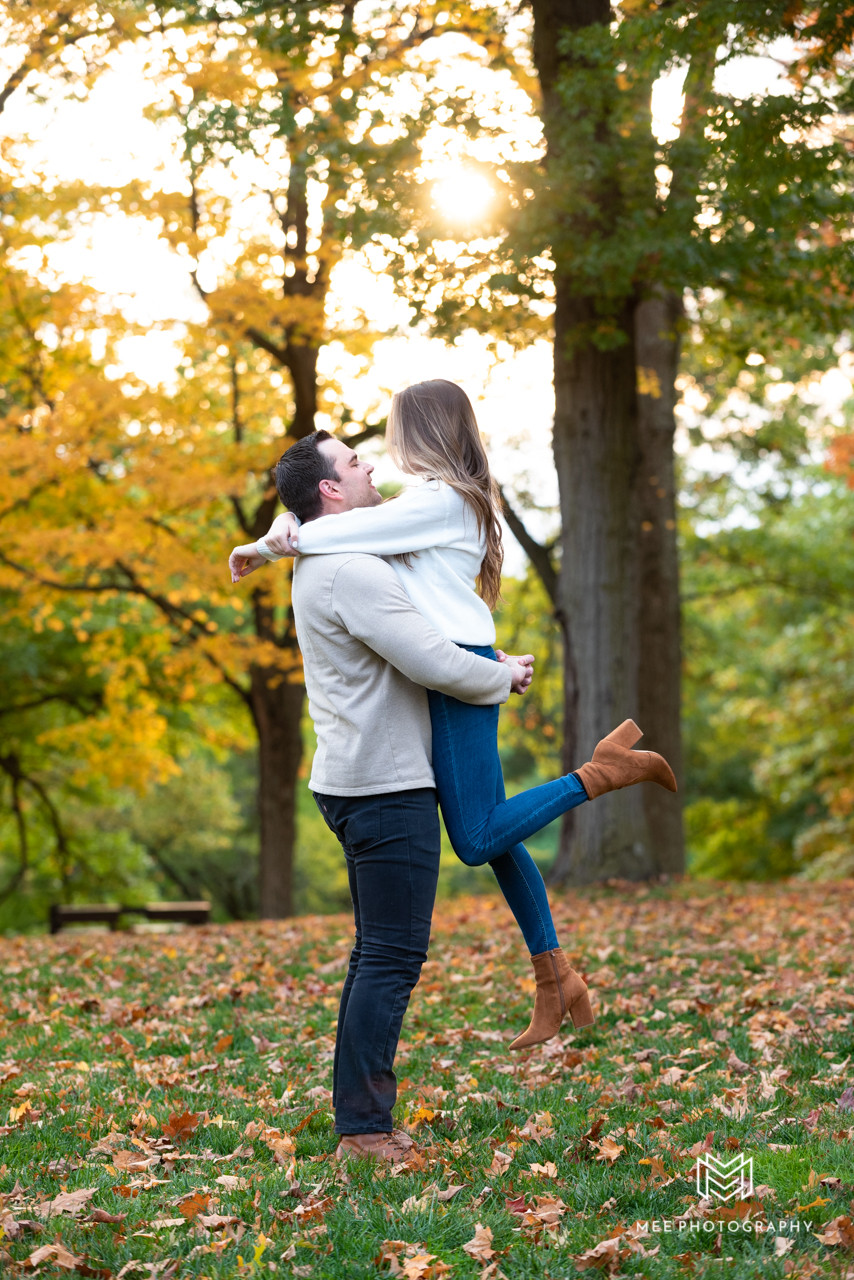 Guy lifting his fiance during engagement photos at Oglebay Park