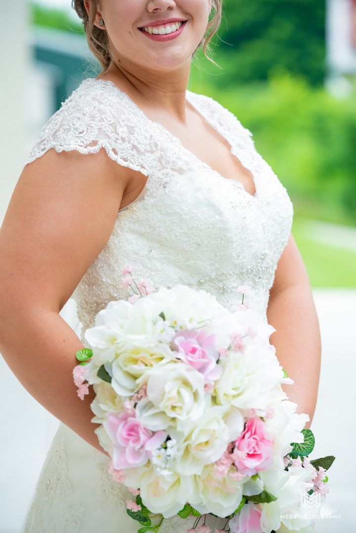 Wedding dress and boquet detail shot