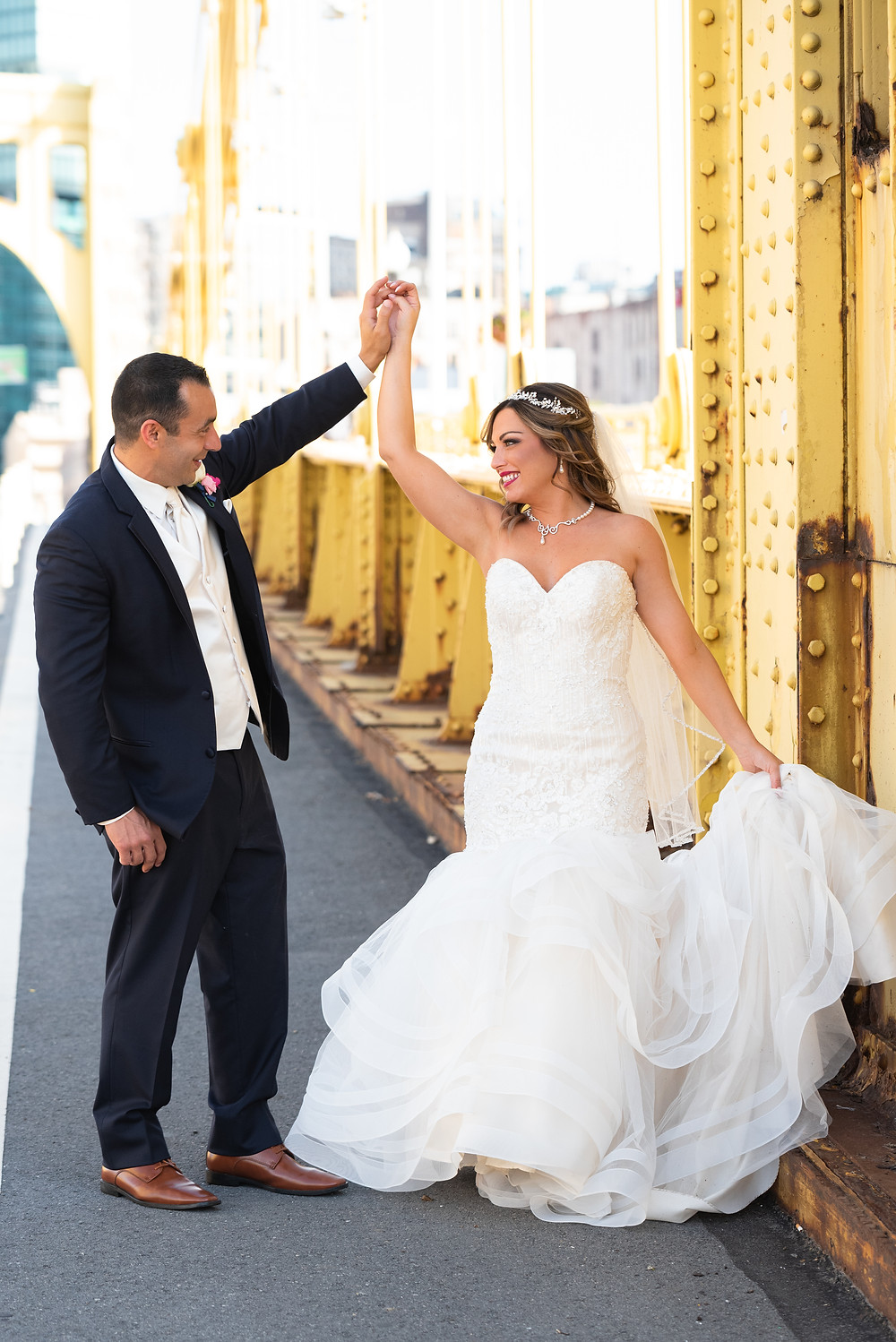 Bride and groom portraits on the Roberto Clemente bridge