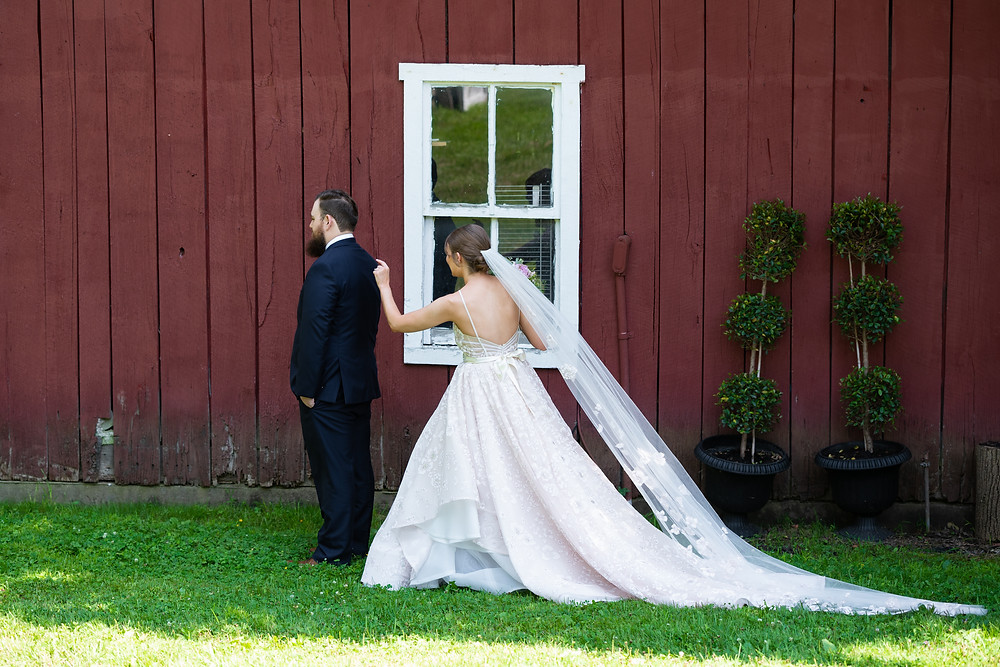 Bride and groom first look at Chanteclaire Farm